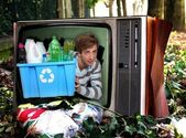 Man in television with recyclable plastic bottles — Stock Photo