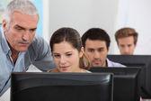 An IT teacher giving a class. — Stock Photo