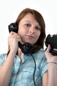 Young woman speaking on the phone — Stock Photo