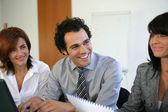 Three businesspeople brainstorming — Stock Photo