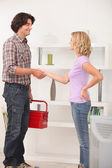 A maintenance man shaking hand with the homeowner. — Stock Photo