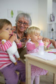 Grandmother taking care of her grandchildren — Stock Photo