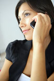 Close-up of brunette using her phone — Stock Photo