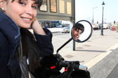 Young woman on a moped in town — Stock Photo