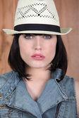 Woman wearing a Panama hat — Stock Photo