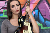 Brunette with electric guitar — Stock Photo