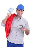 Plumber holding banknotes — Stock Photo