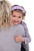 Child hugging a woman — Stock Photo
