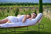 Couple having a nap on sun lounger — Stock Photo
