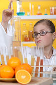 Schoolgirl dressed as biologist — Stock Photo
