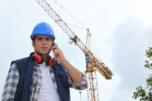 A foreman on his phone onsite. — Stock Photo