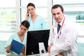 A team of medical professionals at work — Stock Photo