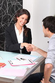 Cheerful woman and man handshaking — Stock Photo
