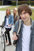 Three teenagers arriving at college — Stock Photo