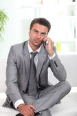 Business man with mobile — Stock Photo