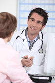 Doctor in appointment with patient — Stock Photo