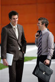 Two young businessmen sharing a joke — Stock Photo