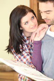 Young woman looking at her boyfriend tenderly — Stockfoto