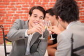 Two colleagues celebrating in restaurant — Stock Photo