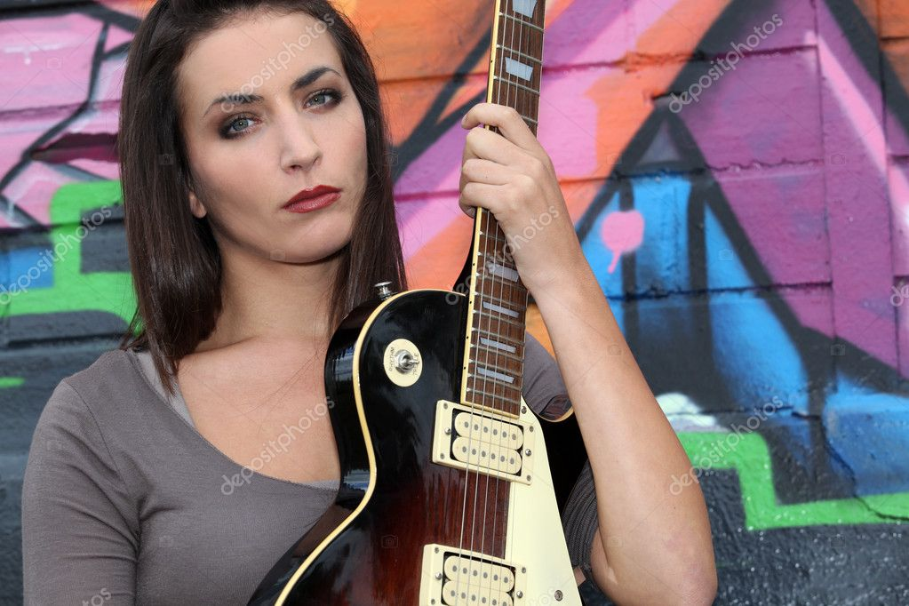 Brunette with electric guitar  Stock Photo #8965060