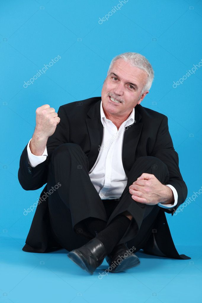 An angry man sitting cross-legged — Stock Photo #8966369