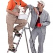 Stock Photo: Happy duo of male painters isolated on white