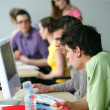 Young men using computer in classroom — Stock Photo #8970048