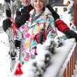 Stock Photo: Couple outside their ski chalet