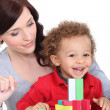 Mother and son with colourful building blocks — Stock Photo