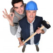 A handyman and his trainee. - Stock Photo