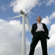 Man standing next to a wind turbine — Stock Photo #8971625