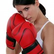 Woman wearing red box gloves — Stock Photo #8971779
