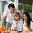 Stock Photo: Family at breakfast