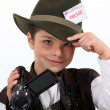 Little girl taking a camera and wearing a costume of journalist — Stock Photo #8971944