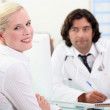 Woman consulting her doctor — Stock Photo