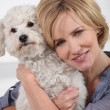 Portrait of a woman with dog — Stock Photo