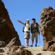 Couple hiking and pointing into the distance - Stock Photo