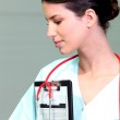 Nurse with a clipboard and stethoscope — Stock Photo #8972457