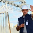 Worker on a construction site waving his hand — Stock Photo #8972472