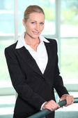 Mature businesswoman smiling — Stock Photo