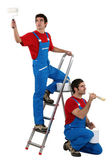 Two decorators wearing matching clothes — Stock Photo