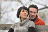 Couple on an autumn stroll — Stock Photo