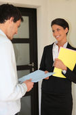 Smart woman giving contract to a man — Stock Photo