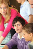 Young man surrounded by his peers — Stock Photo