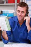 Plumber in office — Stock Photo