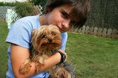 Preteen boy hugging his dog — Stock Photo
