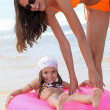 Mother and child at the beach — Stock Photo #9034617