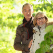 Middle-aged couple walking through park — Stock Photo #9035336