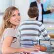 Young woman in geography class — Stock Photo #9036336