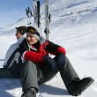 Two skiers sat taking a break — Stock Photo